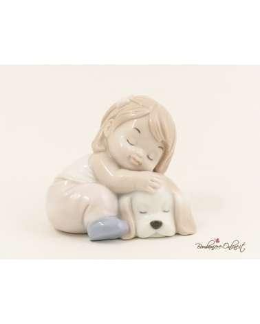Bimba seduta con cagnolino in porcellana lucida