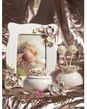 Scatolina piccola con fiori dai colori delicati.