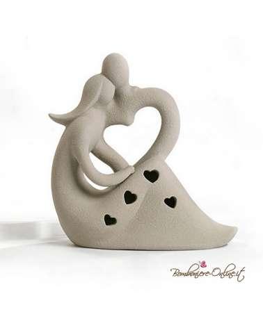 Bomboniera matrimonio Innamorati stilizzati seduti in porcellana color tortora con luce